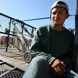 Roman Gonzalez, 17, takes a break from landscaping work to pose for a portrait in Draper on Monday, Aug.  6, 2012.