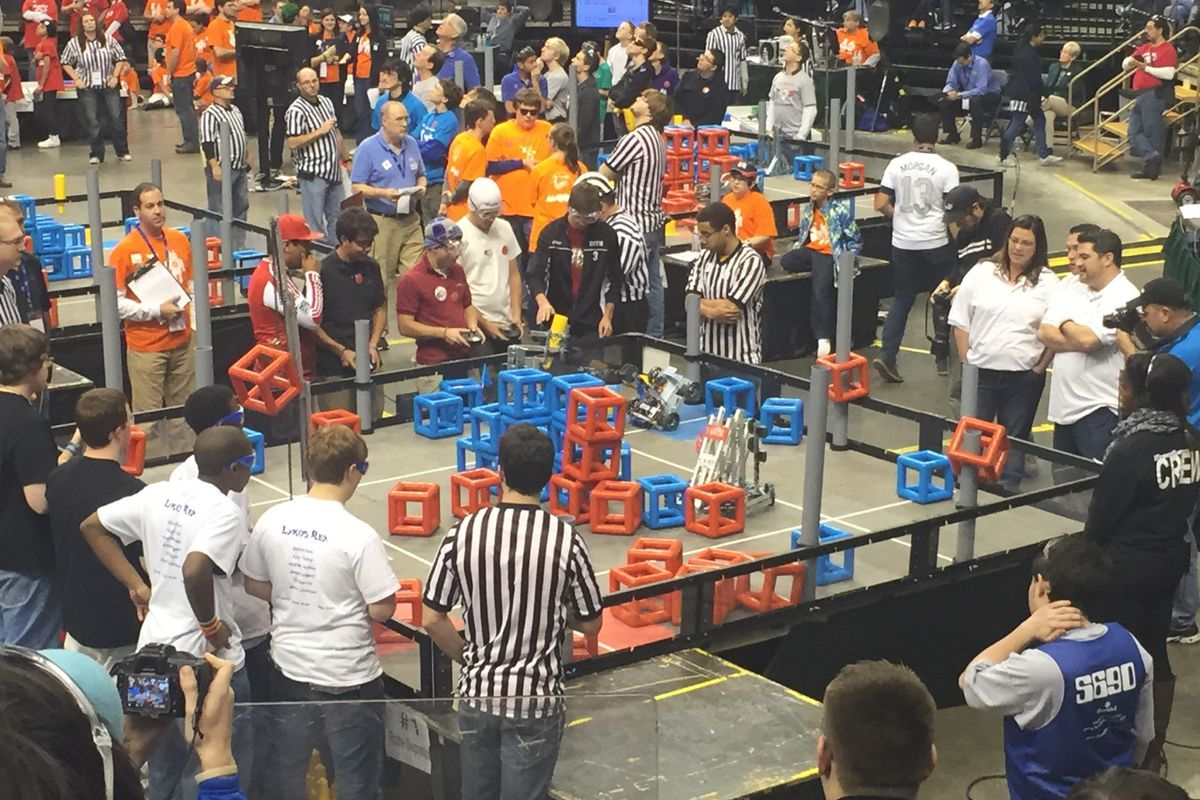 Providence Cristo Rey High School's robotics team competes in the VEX tournament Sunday. The goal of the challenge is to stack cubes on the gray goalposts or build towers in the arena.