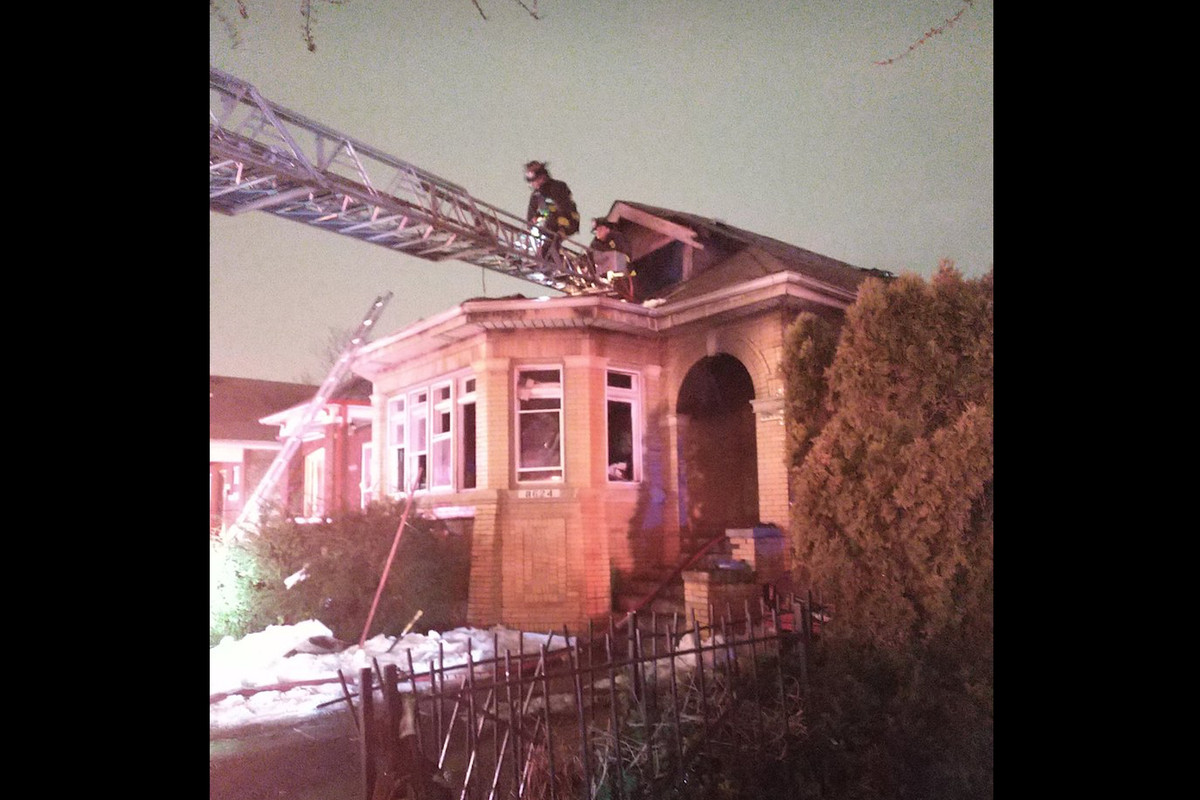 Firefighters work to put out a blaze early Feb. 28 at a bungalow in the 8600 block of South Hermitage Avenue.