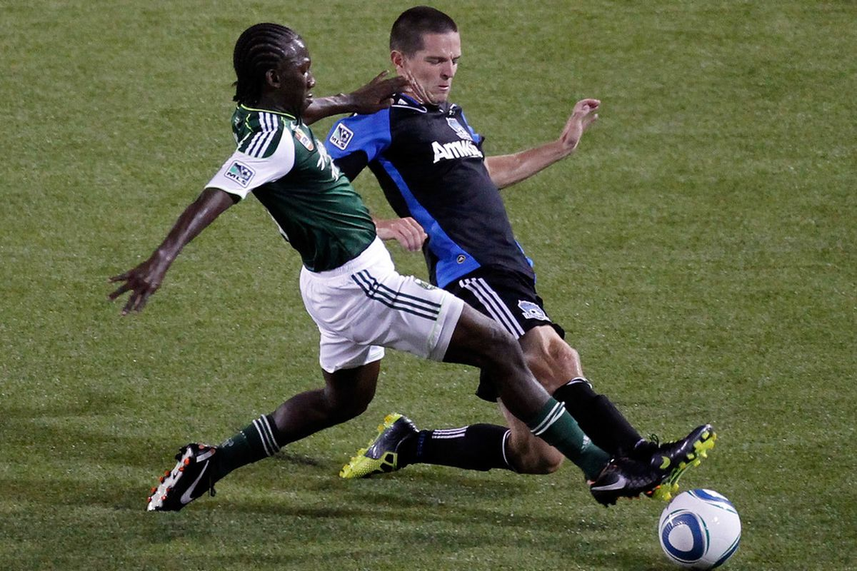 PORTLAND, OR - SEPTEMBER 21: Diego Chara #21 of the Portland Timbers battles Sam Cronin #4 of the San Jose Earthquakes on September 21, 2011 at Jeld-Wen Field in Portland, Oregon.  (Photo by Jonathan Ferrey/Getty Images)