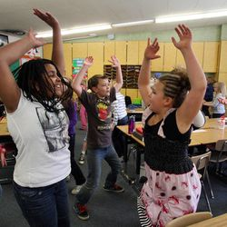 Hannah Costley, left, and Grace Kloberdanz exercise in Nicole Carter's class at Tolman Elementary School in Bountiful, Monday, Nov. 26, 2012.
