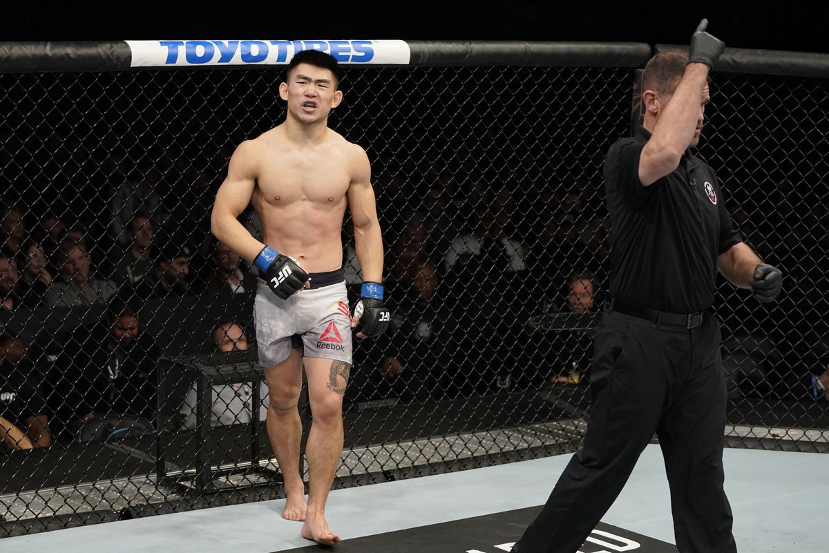 Song Yadong of China reacts after losing a point for an illegal knee in his bantamweight bout against Cody Stamann during the UFC Fight Night event at Capital One Arena on December 07, 2019 in Washington, DC.