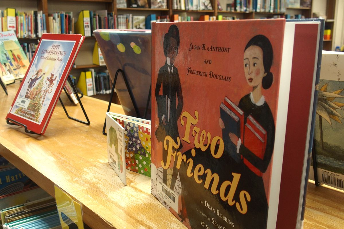 """The book """"Two Friends"""" on a display stand on a shelf in an elementary school library"""
