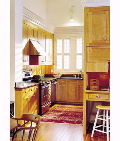 Windows and concealed storage to create a more open kitchen space.
