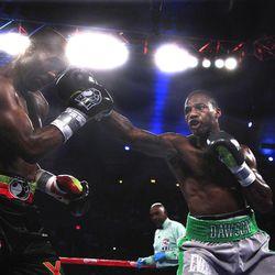 Chad Dawson throws a right at Bernard Hopkins in the third ound of their  light heavyweight boxing match in Atlantic City, N.J., Saturday, April 28, 2012. Dawson won a majority decision.