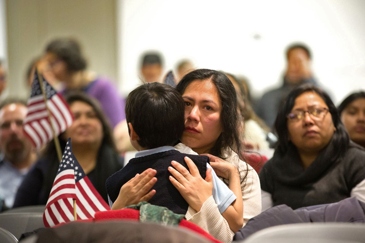 An immigrant family watches Obama's immigration announcement last week.