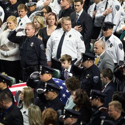 Unified Police Department officer Doug Barney's casket is brought into the Maverik Center in West Valley City on Monday, Jan. 25, 2016.