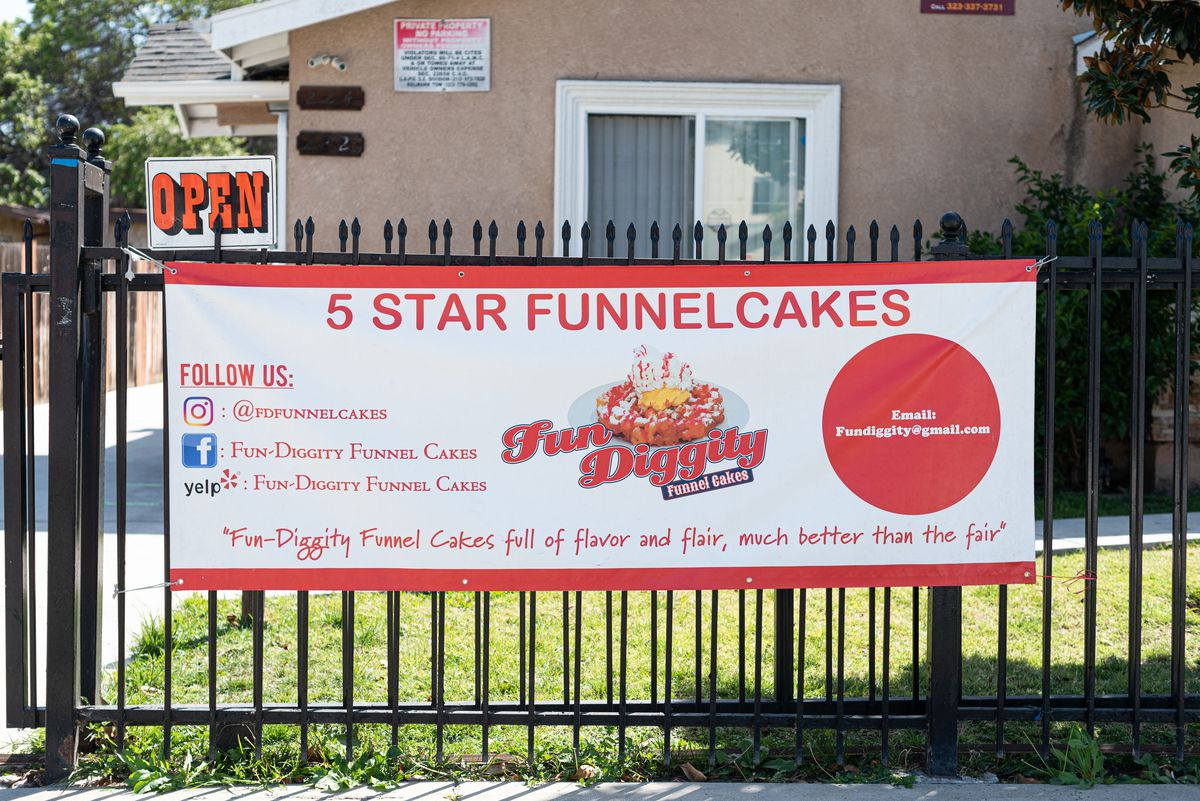 A sign for Fun Diggity funnel cakes in Compton, California.