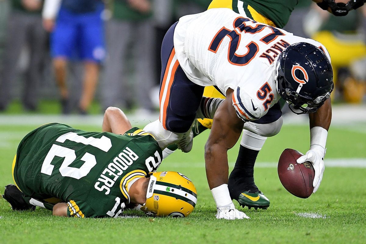 Aaron Rodgers of the Green Bay Packers lays on the ground after getting  crushed as Khalil Mack takes off with the football. Photo by Stacy  Revere Getty ... c2be64cc9