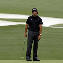 Phil Mickelson misses a putt on the 10th hole during the first round of the Masters golf tournament Thursday, April 5, 2012, in Augusta, Ga.