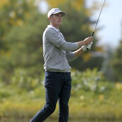 Ridgeline's Zach Skinner hits the ball on the third hole during the second round of the 4A boys state golf tournament on Thursday, Oct. 7, 2021, in Smithfield.