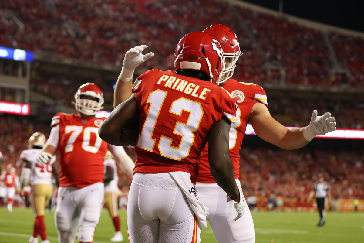 Kansas City Chiefs wide receiver Byron Pringle (13) is congratulated by his lineman after a 6-yard touchdown run in the third quarter of an NFL preseason game between the San Francisco 49ers and Kansas City Chiefs on August 24, 2019 at Arrowhead Stadium in Kansas City, MO.