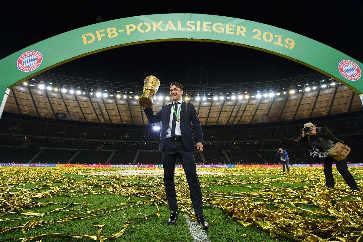 BERLIN, GERMANY - MAY 25: Niko Kovac, Manager of Bayern Munich celebrates with the DFB Pokal following his team's victory in the DFB Cup final between RB Leipzig and Bayern Muenchen at Olympiastadion on May 25, 2019 in Berlin, Germany.