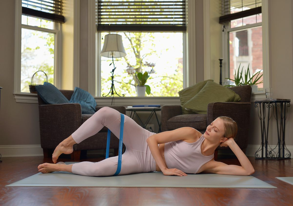 """Joffrey Ballet dancer Brooke Linford demonstrates the proper way to do """"clamshells,"""" her favorite at-home workout exercise. As a general exercise, the clamshell can help strengthen your medial glutes, bringing more power and stability to your hips."""