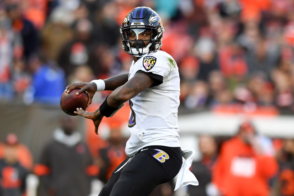 Quarterback Lamar Jackson #8 of the Baltimore Ravens throws a 12-yard touchdown to running back Mark Ingram in the third quarter of a game against the Cleveland Browns on December 22, 2019 at FirstEnergy Stadium in Cleveland, Ohio. Baltimore won 31-15.