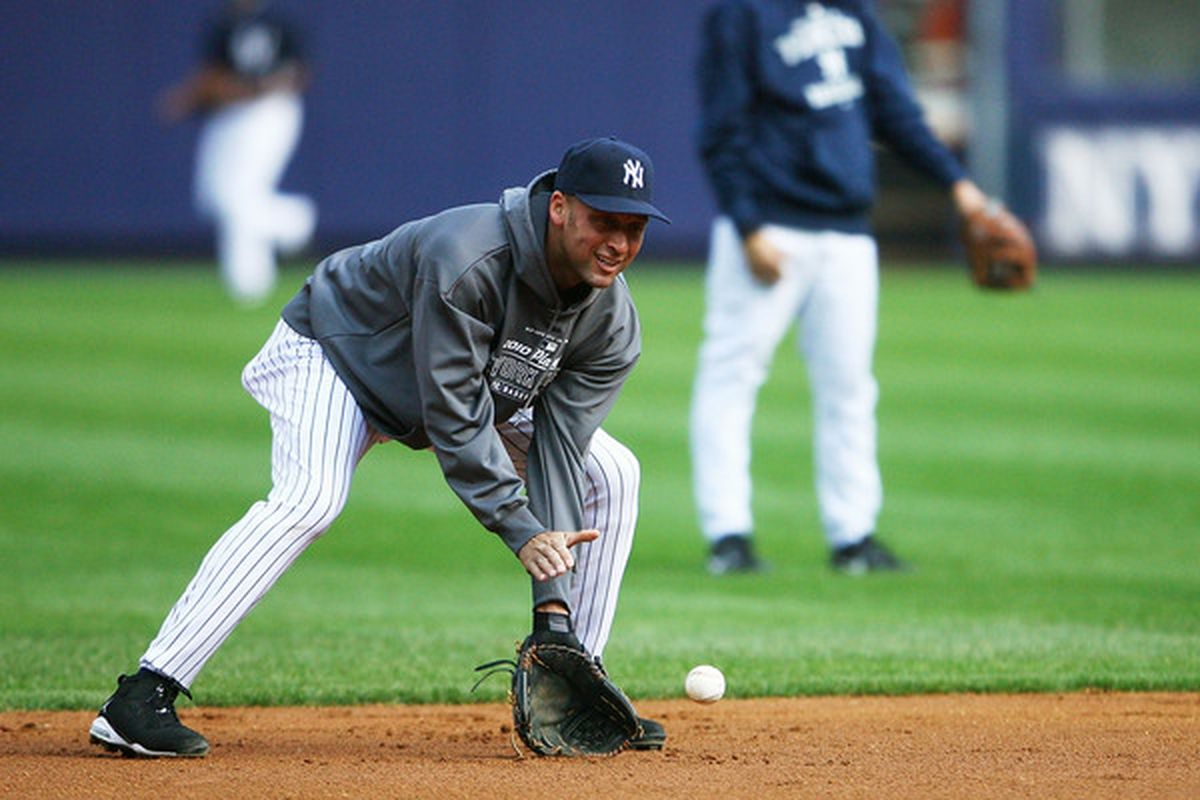NEW YORK - OCTOBER 12:  Derek Jeter #2 of the New York Yankees fields a ground ball during a workout session at Yankee Stadium on October 12, 2010 in the Bronx borough of New York City.  (Photo by Andrew Burton/Getty Images)
