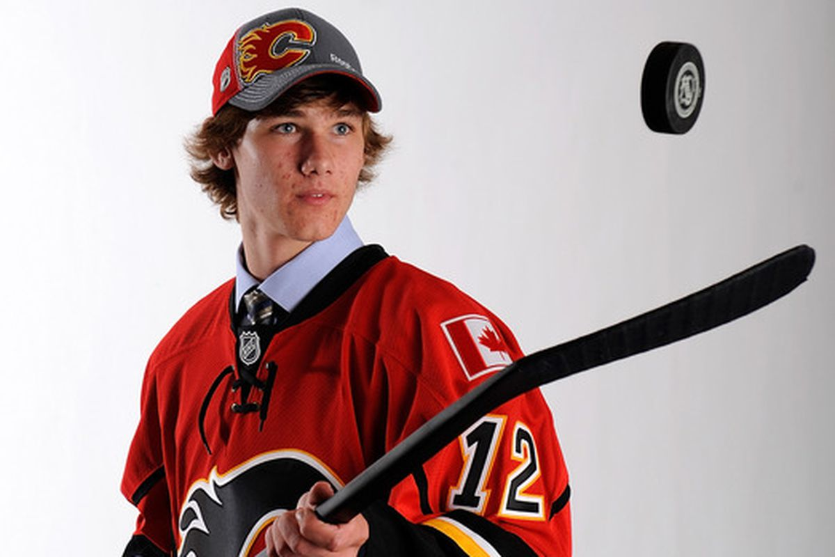Providence forward Mark Jankowski poses for pictures after being drafted by the Calgary Flames in the 2012 NHL Draft.