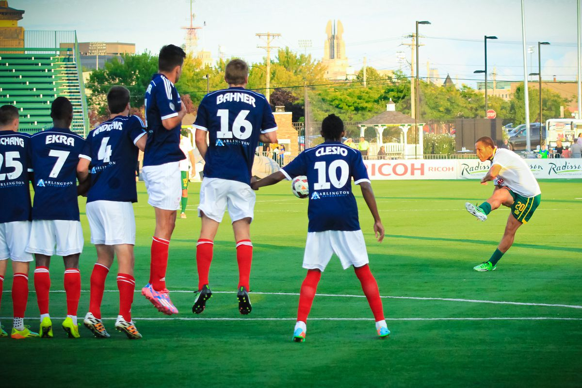 Tony Walls curls in a free kick for Rochester's first goal