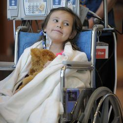 Seven-year-old Sierra Jane Downing from Pagosa Springs, Colo., smiles during a news conference about her recovery from bubonic plague at the Rocky Mountain Hospital for Children at Presbyterian/St. Luke's Wednesday, Sept. 5, 2012, in Denver. It is believed Downing caught the bubonic plague from burying a dead squirrel.