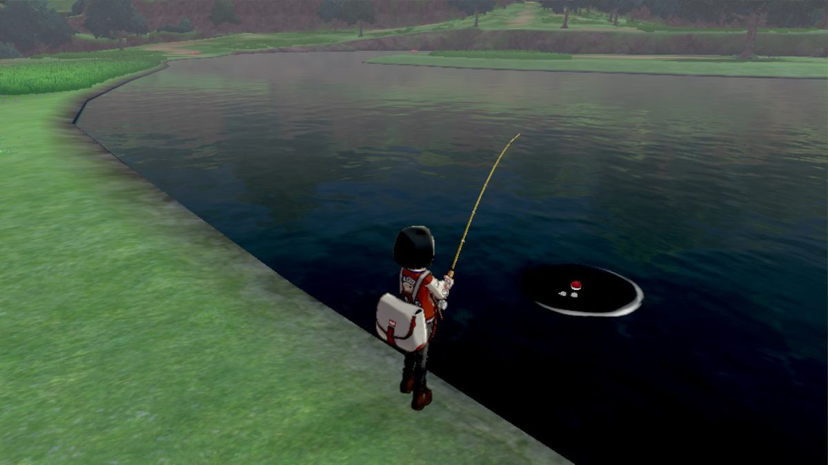 A Pokémon trainer fishes in the Wild Area