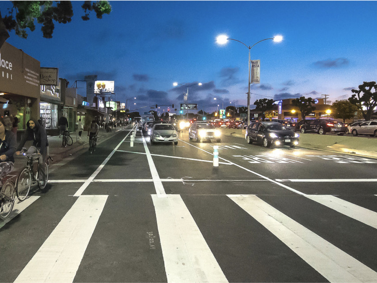 The project reduced the number of traffic lanes on a portion of Venice Boulevard, adding high-visibility crosswalks and protected bike lanes.
