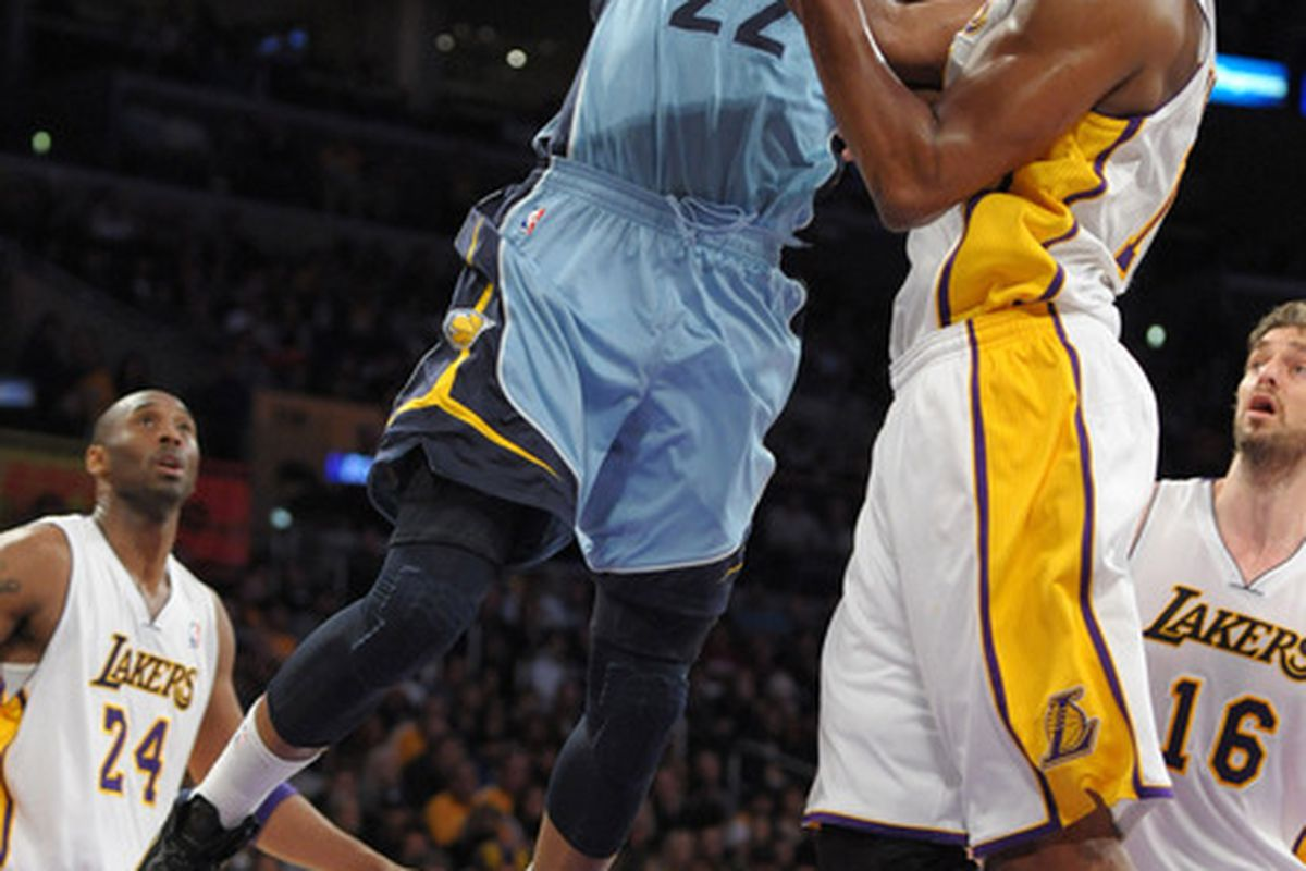 Mar 25, 2012; Los Angeles, CA, USA; Memphis Grizzlies forward Rudy Gay (22) dunks the ball against Los Angeles Lakers center Andrew Bynum (17) at the Staples Center. Mandatory Credit: Kirby Lee/Image of Sport-US PRESSWIRE