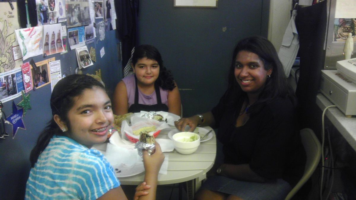 Laurel Collins with her daughters Emily and Sarah after a burrito-making class with Julie King