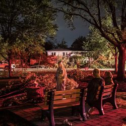 Bridget Casey sits in the driveway of her severely damaged home on the 7800 block of Woodridge Dr. In Woodridge with son Nate, 16, and daughter Marion, 14 at approximately 2:30 am Monday morning.
