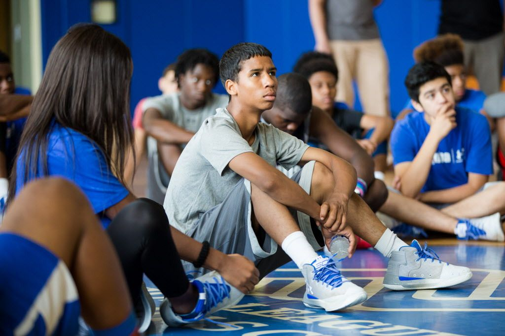 Elio Esquivel, 13, listens to police officers at the Union League Boys & Girls Club on Thursday, July 27, 2017. | Santiago Covarrubias/For the Sun-Times
