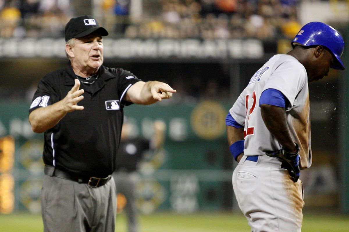 Pittsburgh, PA, USA; Third base umpire Bob Davidson calls Chicago Cubs left fielder Alfonso Soriano out for base runners interference against the Pittsburgh Pirates at PNC Park. The Pittsburgh Pirates won 1-0.  Credit: Charles LeClaire-US PRESSWIRE