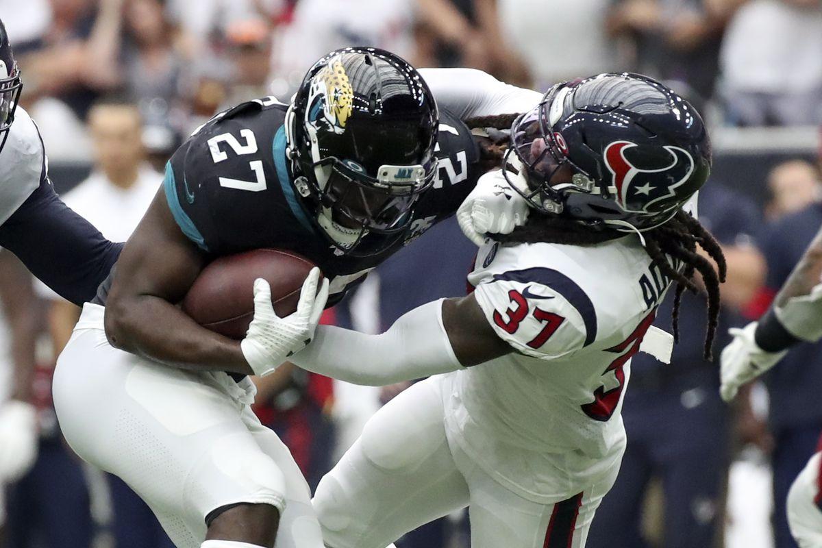 Houston Texans strong safety Jahleel Addae tackles Jacksonville Jaguars running back Leonard Fournette during the second half at NRG Stadium.