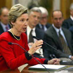 Former Salt Lake City Mayor Deedee Corradini testifies as Mayor Rocky Anderson and other listen during a Salt Lake City Council fact-finding hearing on the intent of the LDS Church's Main Street Plaza purchase, Utah Dec. 10, 2002.