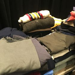 Men's tee-shirts ($50) and sweaters ($120)