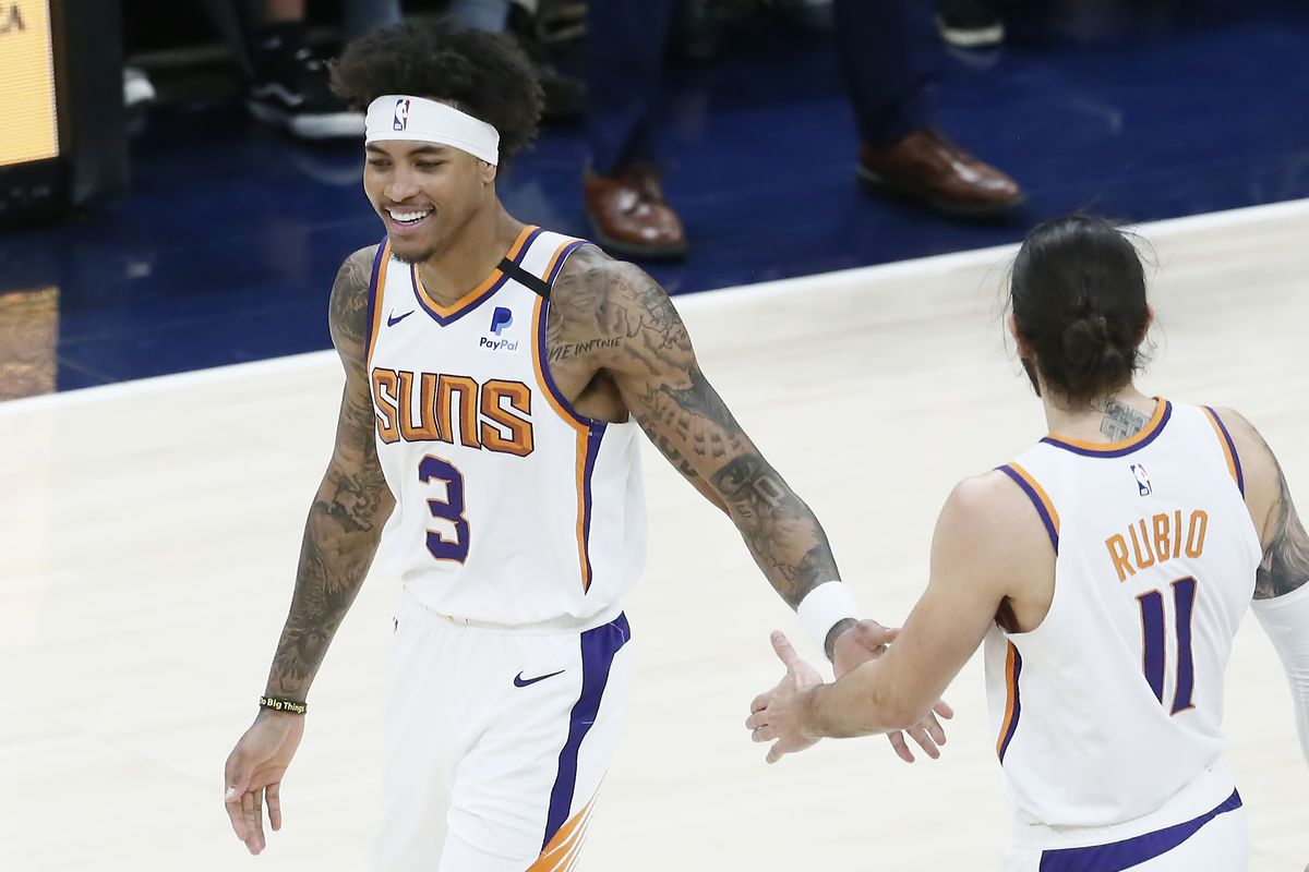 Kelly Oubre Jr. of the Phoenix Suns celebrates with Ricky Rubio #11 of the Phoenix Suns during a game at the Arco Arena on February 24, 2020 in Salt Lake City, UT.