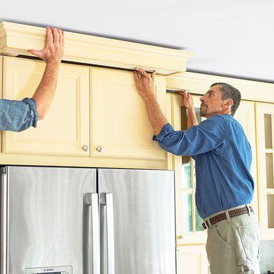 Men Installing Kitchen Crown Molding