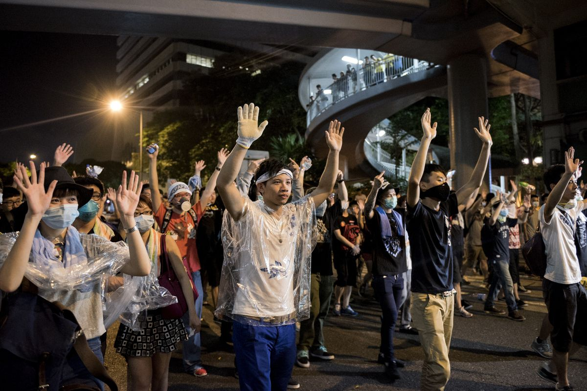 Protesters raise their arms in Hong Kong