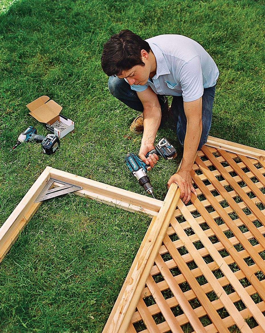 Man Assembles And Attaches Side Panel Frames And Lattice