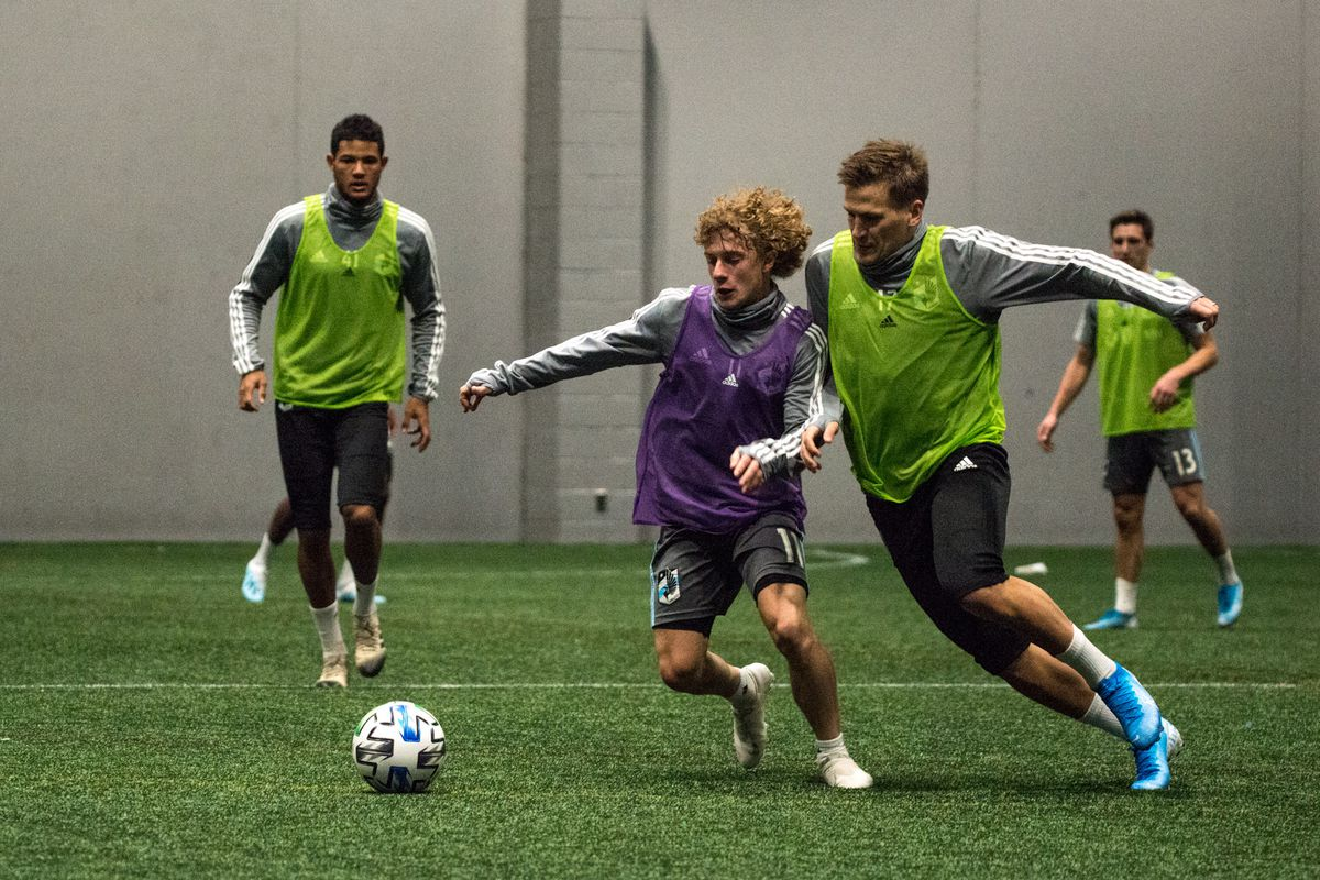 January 21, 2020 - Blaine, Minnesota, United States - Thomas Chacon and Robin Lod fight for a ball during a training session at National Sports Center. (Photo by Tim McLaughlin