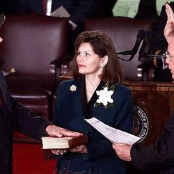 Gov. Mike Leavitt is sworn in by Chief Justice Richard C. Howe, as first lady Jacalyn S. Leavitt holds Bible during the inaugural ceremony on  Jan. 4, 2001.