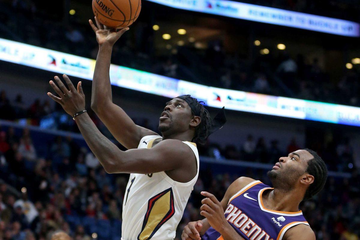 3ea0d2ddcdbf Jrue Holiday shuts down Devin Booker as New Orleans Pelicans breeze past  Phoenix Suns
