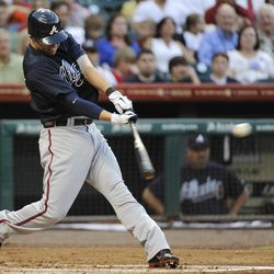 Atlanta Braves' Tyler Pastornicky swings for an RBI single against the Houston Astros in the second inning of a baseball game Monday, April 9, 2012, in Houston.