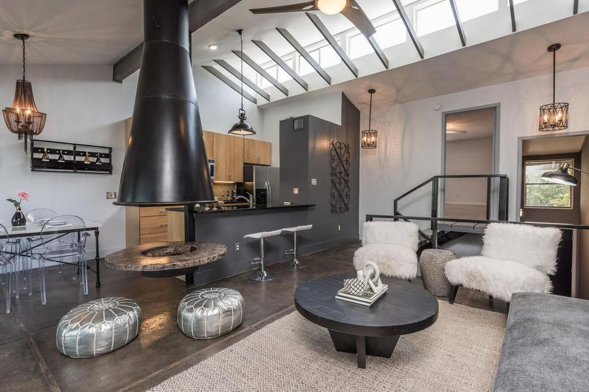 Photo of townhouse living room with floating fireplace