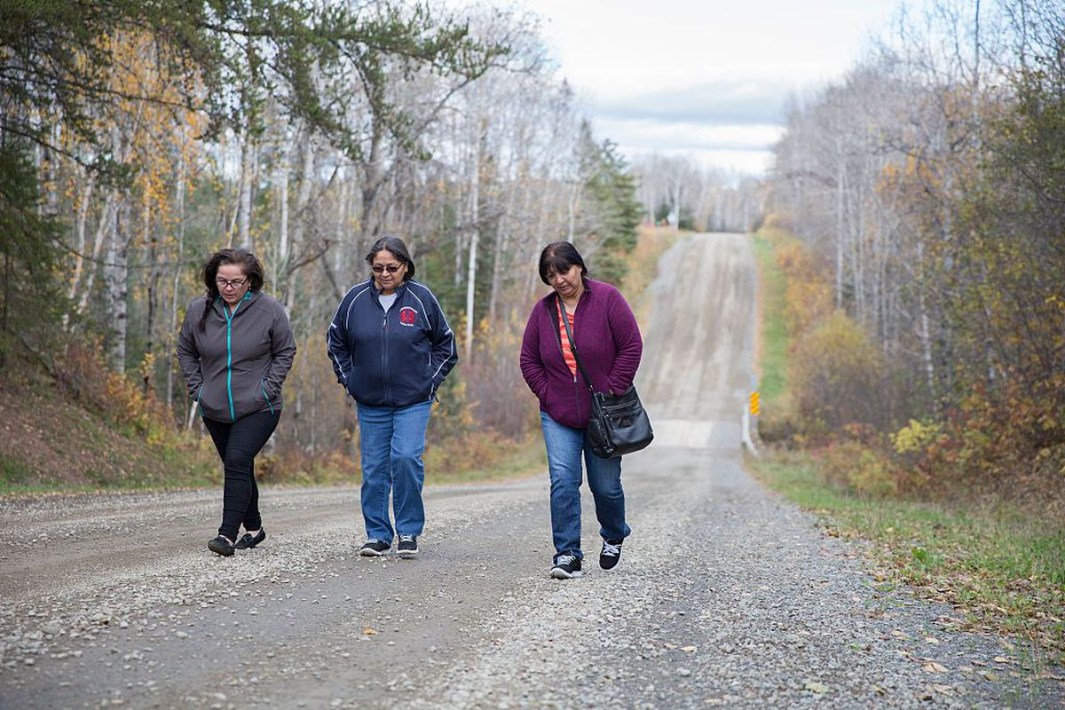 Melissa Skunk, Maryanne Panacheese and Mary Skunk from Mishkeegogamang First Nation near the site where the body of missing woman Rena Fox was found in 2015, in Thunder Bay, Ontario.