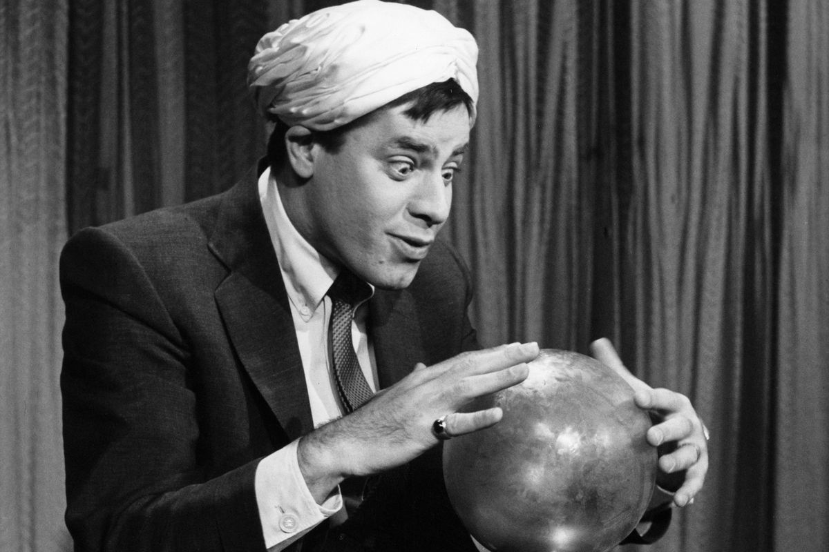 """Jerry Lewis as """"Swami"""" staring into a crystal ball"""