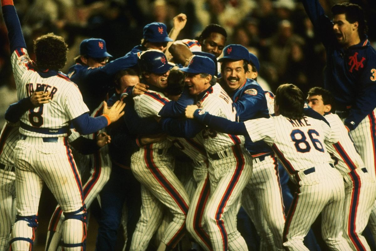 The 1986 New York Mets celebrate after winning the World Series.