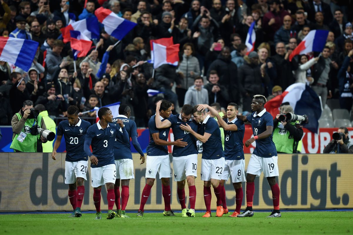 The French celebrated after a goal scored around the same time as the explosions began.