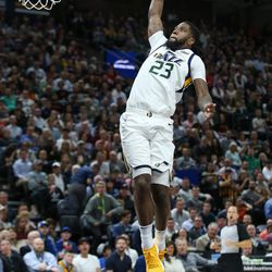 Utah Jazz forward Royce O'Neale (23) puts in a breakaway dunk during the game against the Golden State Warriors at Vivint Arena in Salt Lake City on Tuesday, April 10, 2018.