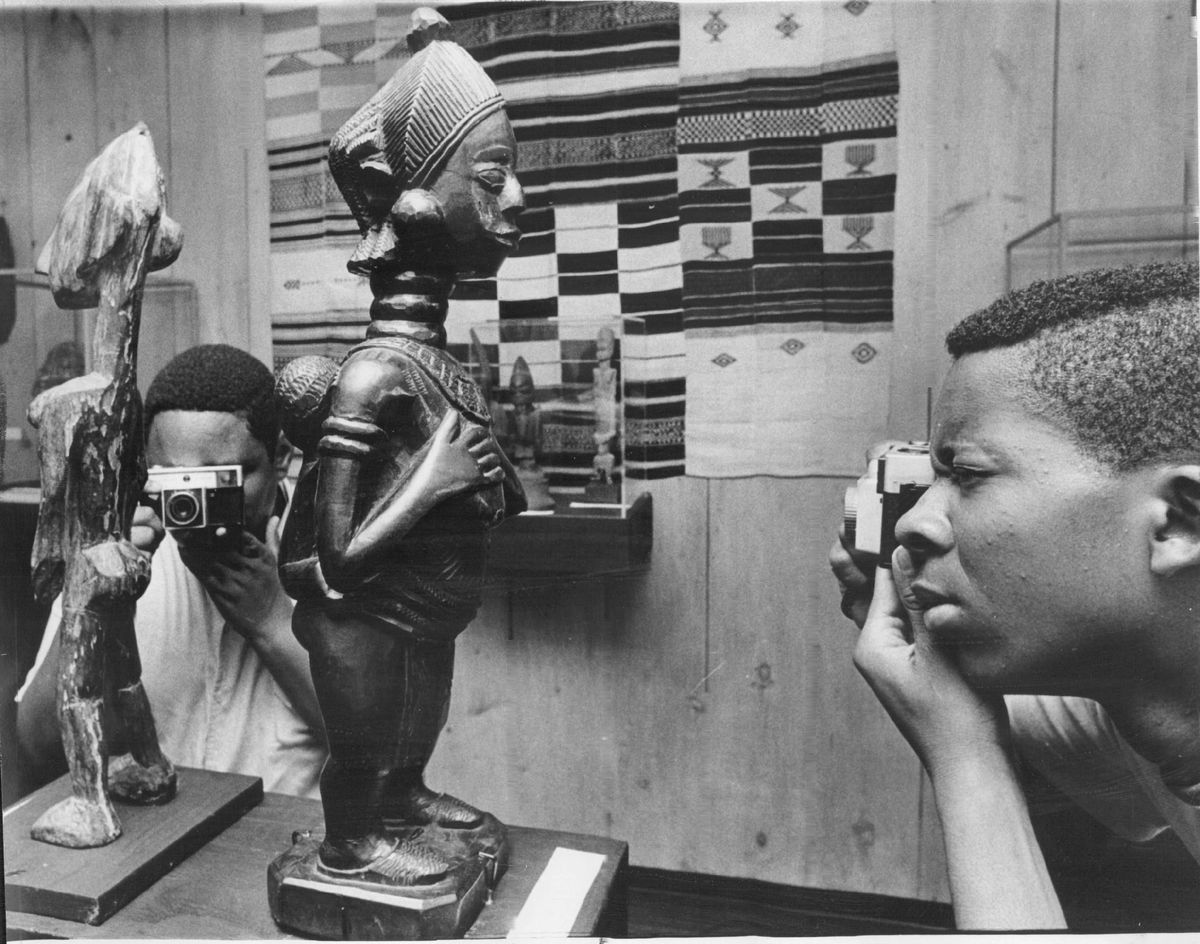Arthur Brown (left) and Arthur Cockrell take photos at an African art exhibit at the South Side Community Art Center in 1968.