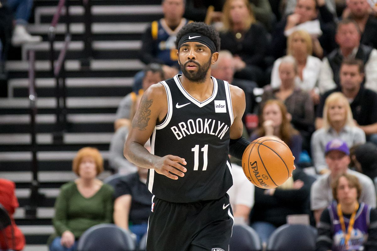 Brooklyn Nets guard Kyrie Irving dribbles up the court during the second half against the Utah Jazz at Vivint Smart Home Arena.