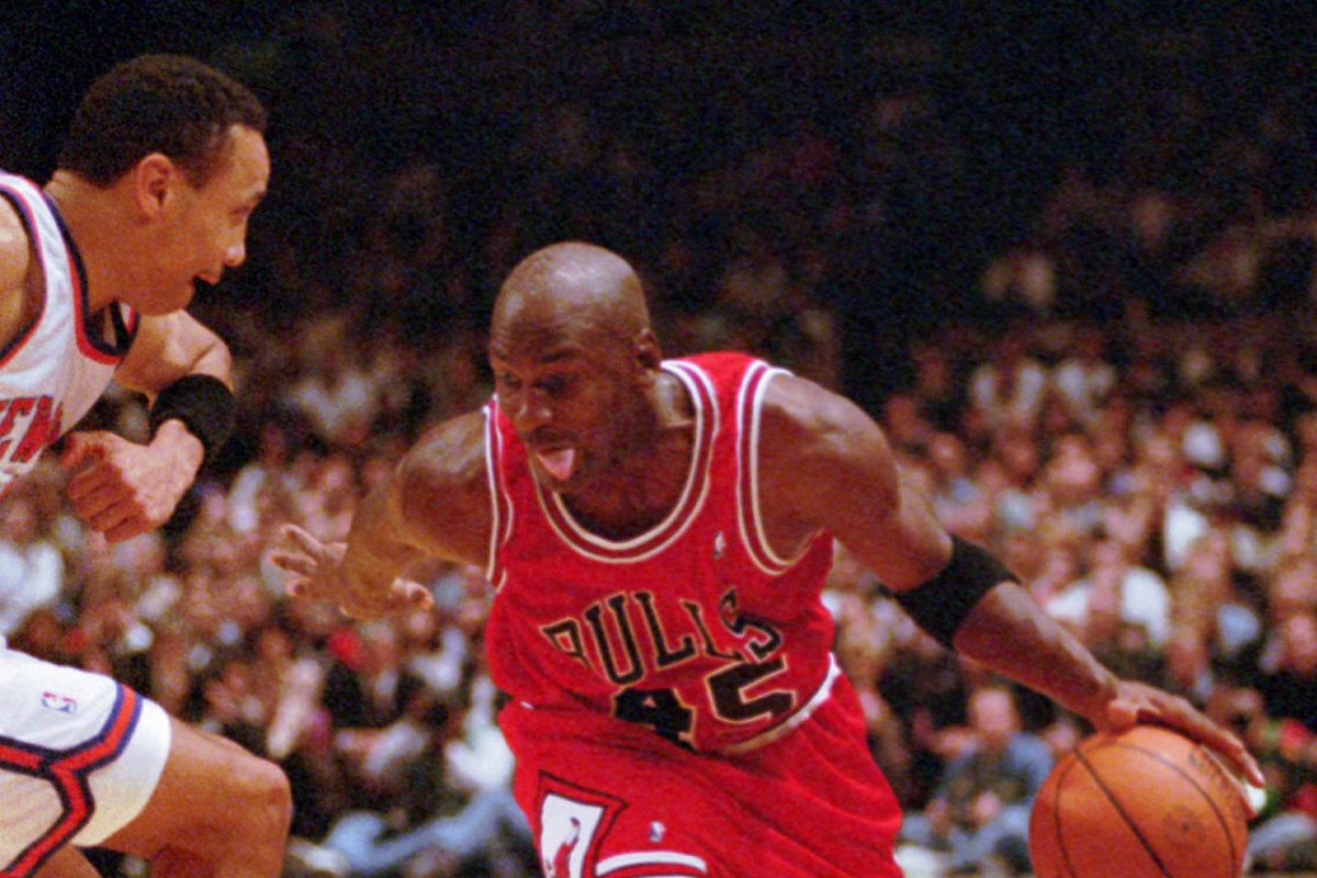 Bulls guard Michael Jordan (45) drives past New York Knicks guard John Starks at New York's Madison Square Garden Tuesday, March 28, 1995. Jordan scored 55 points as the Bulls won 113-111.